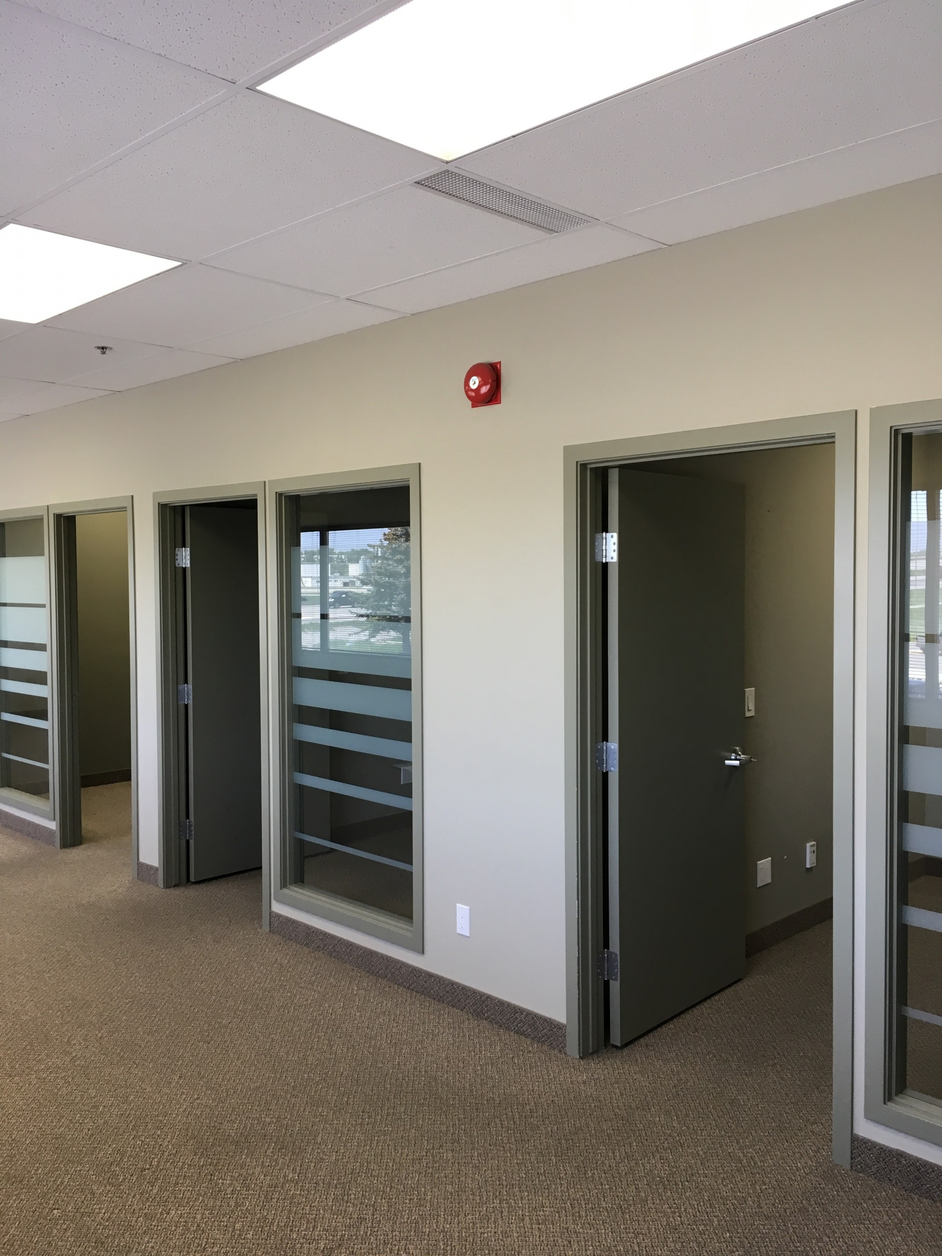 Interior photo of newly renovated office space in a light grey neutral colour scheme.
