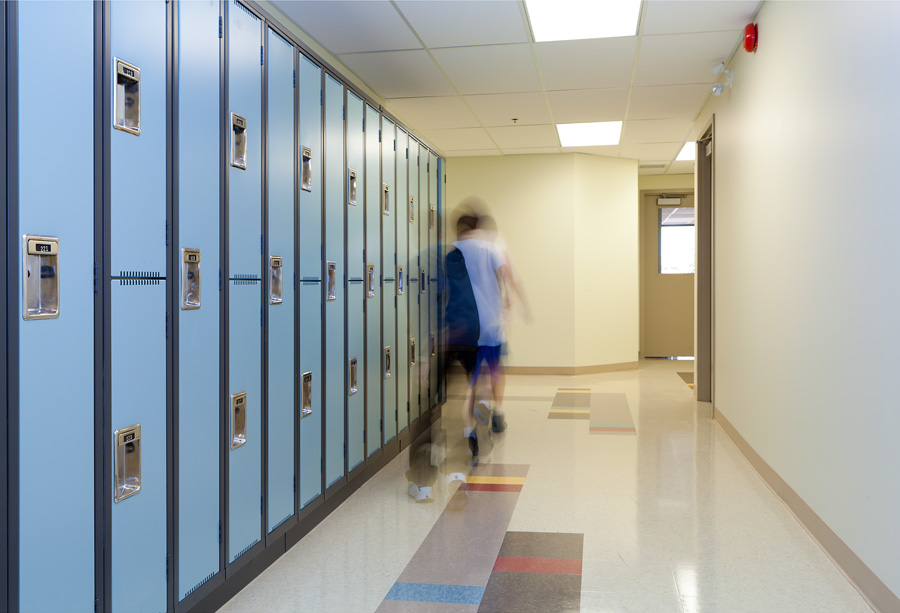 Junior high hallway showing new lockers and floor patterns to improve student circulation.